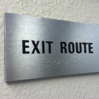 Exit-Route-Tactile-Letters-on-Brushed-Aluminum-600x403